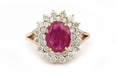A 14 karat gold ruby and diamond cluster ring. Featuring an oval cut ruby of ca. 1.40 ct. in a surround of thirty two brilliant cut diamonds, ca. 1 ct. in total, ca. I-J, ca. VS-SI. Gross weight: 6.3 g.