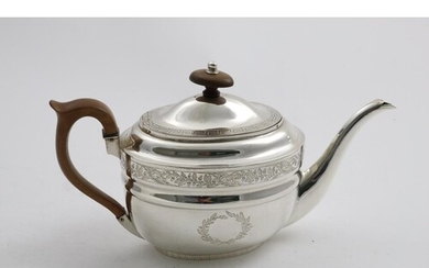 A GEORGE III ENGRAVED OVAL TEA POT with two vacant wreath ca...