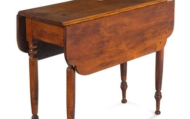 A Late Federal Cherrywood and Maple Drop Leaf Table