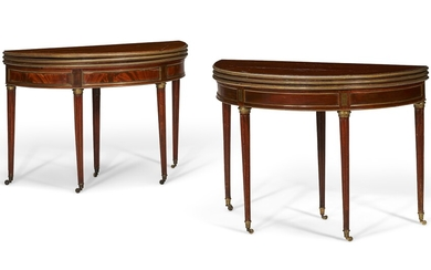 A MATCHED PAIR OF LATE LOUIS XVI ORMOLU-MOUNTED MAHOGANY GAMES TABLES