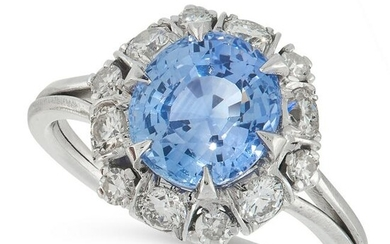 A SAPPHIRE AND DIAMOND DRESS RING set with a cushion