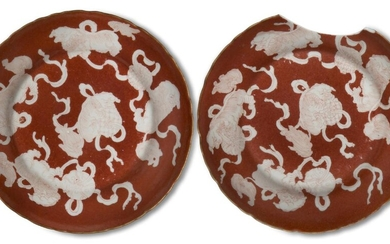 A pair of Chinese porcelain iron-red reverse-decorated 'shi' dishes, late Qing dynasty, each painted with five guardian lions with balls on coral-red ground, 13.5cm (2)