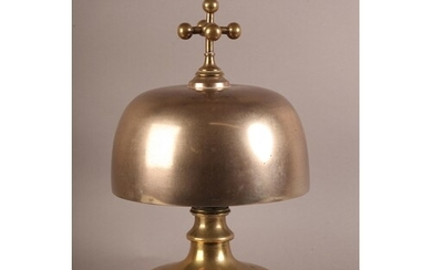 AN UNUSUAL AND LARGE BRONZE, cast iron and brass table bell ...