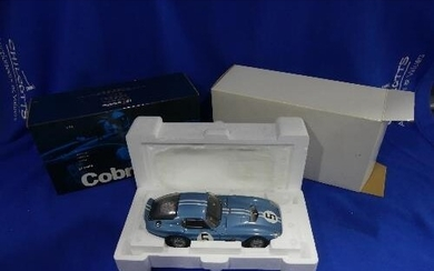 An Exoto 'Racing Legends' series 1:18 scale model of the 196...