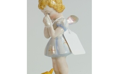 Beswick rare figure of a Fairy with buttercup 1011