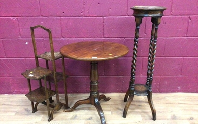 Georgian mahogany tilt top wine table, oak two tier torchere with spiral twist supports and an oak folding cake stand