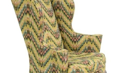 Queen Anne Upholstered Wing Chair having rolled out