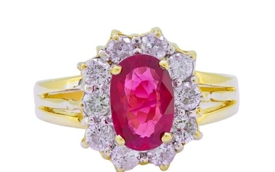 RUBY AND DIAMOND CLUSTER RING, in 18-ct gold, set with a cen...