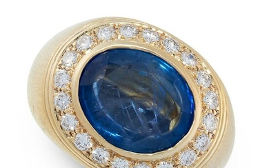 SAPPHIRE AND DIAMOND RING set with an oval cut sapphire