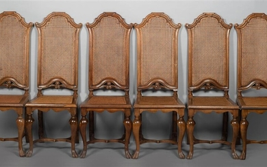 SUITE OF SIX CONTINENTAL ROCOCO STYLE CANED WALNUT STAINED DINING CHAIRS