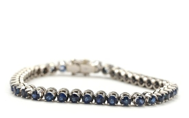 Sapphire bracelet set with numerous faceted sapphires totalling app. 8.20 ct., mounted in 18k white...