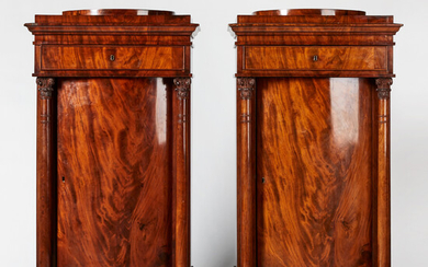 1763878. COLUMN CABINET, a pair, empire, first half of the 19th century, architectural form, mahogany veneered.