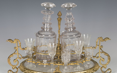 A 20th century French ormolu and cut glass liquor stand of oval form, fitted with two decanters and