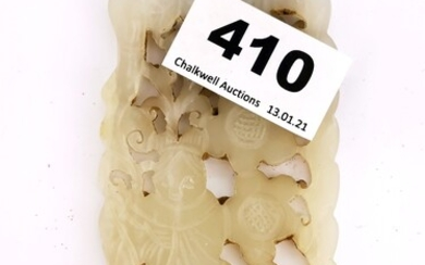 A Chinese carved pale celadon jade panel of a woman surround by flowers, 5.5 x 9.5cm.
