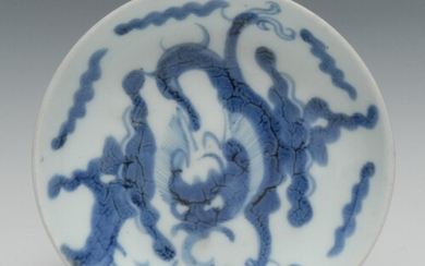 A Chinese circular dish, painted in tones of underglaze blue...