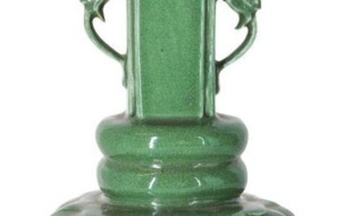 A Chinese monochrome porcelain apple-green crackle-glazed vase, 18th century, the lobed body topped with two bands rising to a straight neck with applied dragon handles, 21.6cm high Provenance: Private French collection