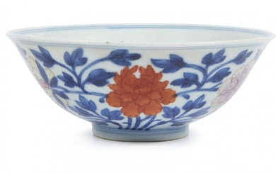 A Chinese porcelain 'peonies' bowl, Qianlong minyao mark and of the period, painted in underglaze blue and famille rose enamels with peonies to the exterior, the flowers picked out in enamels, the leafy stems in underglaze blue, 13cm diameter
