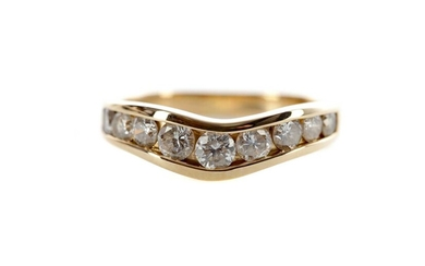 A DIAMOND NINE STONE RING