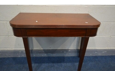A GEORGIAN MAHOGANY FOLD OVER TEA TABLE with rounded and ree...