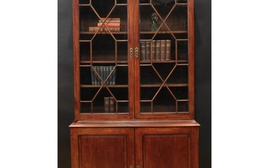 A George II mahogany library bookcase, moulded dentil cornic...