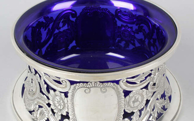 A George V silver dish ring with blue glass liner.