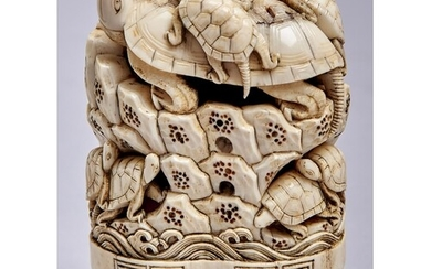 A Japanese ivory okimono, Meiji period, carved with turtles ...