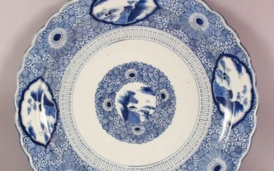 A LARGE JAPANESE MEIJI PERIOD BLUE & WHITE PORCELAIN CHARGER...