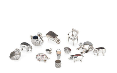 A collection of twelve silver novelty pin cushions
