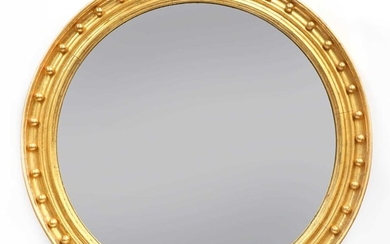 A large Regency-style convex wall mirror