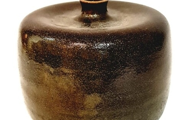 A later 20th Century studio pottery vase of compressed barre...