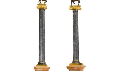A pair of Empire style gilt-bronze mounted fossilized grey marble columns, late 19th / early 20th century