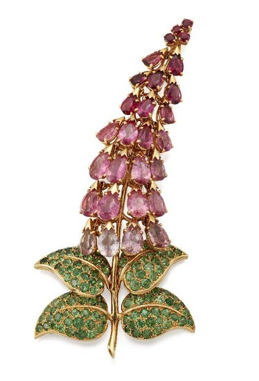 Amendment: please note that the brooch is additionally stamped with later British import marks for London 1992, Garrards & Co.A tourmaline and garnet brooch by René Boivin, modelled as a foxglove with pear shaped shaded pink tourmaline articulated...