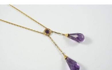 AN AMETHYST DROP NECKLACE formed with two briolette amethyst...