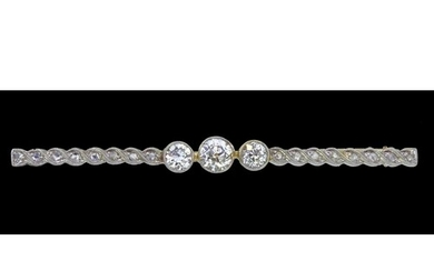 DIAMOND BAR BROOCH, set with 3 larger diamonds to the center...