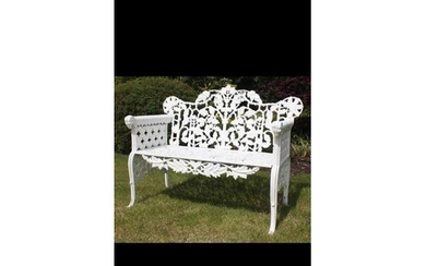 Decorative cast iron garden bench with arms terminating in R...