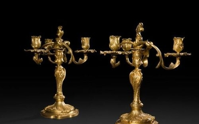 Pair of three-light gilt bronze candelabra, the shaft with an...