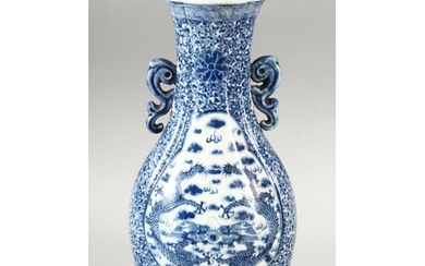 A CHINESE BLUE & WHITE PORCELAIN TWIN HANDLE VASE, decorated...