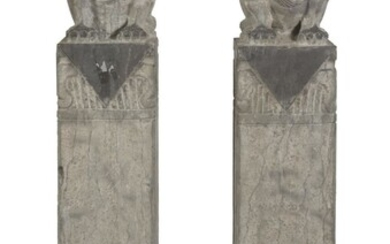 A PAIR OF SCHISTO COLUMNS WITH BUDDHIST LIONS. 20TH CENTURY.