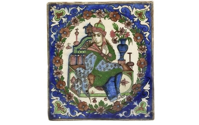 A POTTERY TILE DEPICTING A SEATED PRINCE Late Qajar or Early Pahlavi Iran, early 20th century