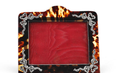A Victorian silver-mounted tortoiseshell photograph frame