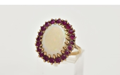 A YELLOW METAL OPAL AND RUBY CLUSTER RING, large cluster cen...