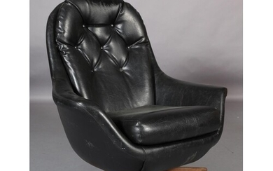 A black buttoned leatherette swivel armchair on a wooden fou...