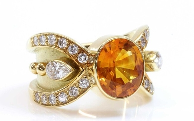 A golden yellow sapphire and diamond band ring