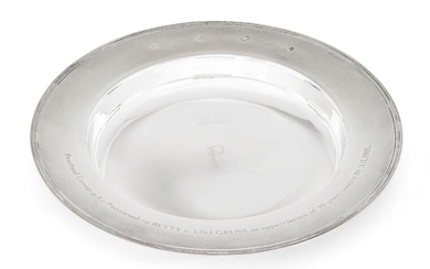 A large silver armada dish by Garrard & Co., Sheffield, c.1992, of plain circular form with reeded band and presentation engraving to rim, the base engraved with the letter 'P', 30.6cm dia., approx. weight 32.5oz