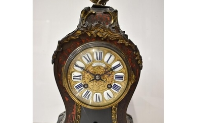 A late 19th century French Boulle mantle clock, the red tort...