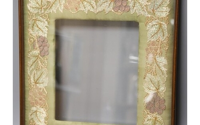 A mahogany picture frame with needlework mount 48x42cm...