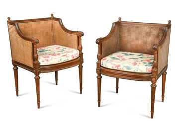 A pair of neo-classical mahogany bergeres, early 20th century