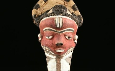 AN AFRICAN RED PAINTED MASK, PROBABLY BAULE PEOPLE