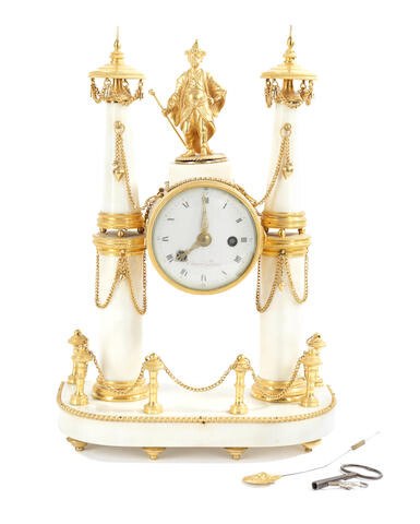 An early 19th century gilt bronze and white marble figural portico clock