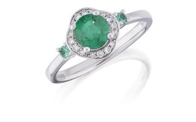An emerald and diamond cluster ring, the circular emerald, weighing approximately 0.87 carats, to a brilliant-cut diamond lobed surround and circular emerald single stone shoulders, hoop signed David Jerome, ring size N Accompanied by report number...